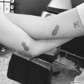 matching-pineapple-tattoos-on-the-inner-arm