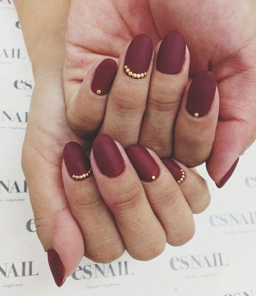 dark-red-matte-nails-with-gold-details